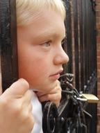 Sad boy locked fence