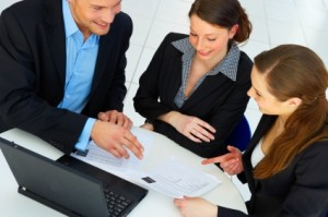 teamwork, one business man and two women in front of computer