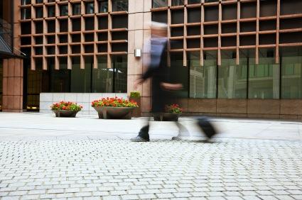 blur of man on city sidewalk