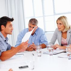 4 business people in meeting